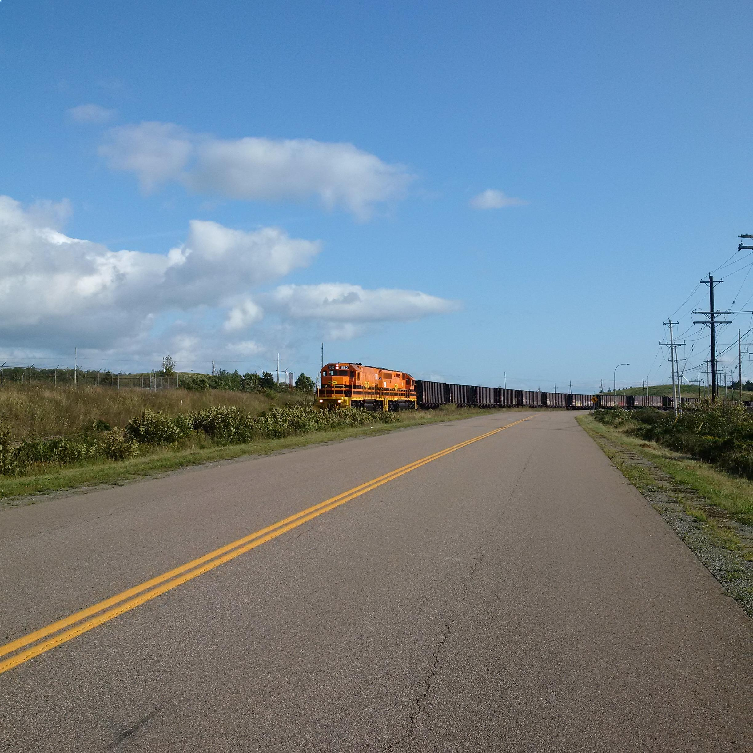 A train travelling along a road representing the Cape Breton and Central Nova Scotia Railway