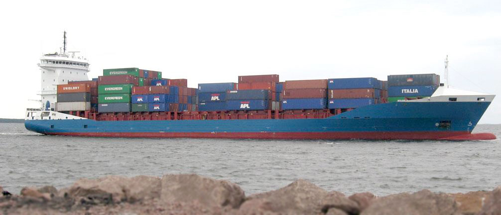 A short sea shipping container ship travels a seaway